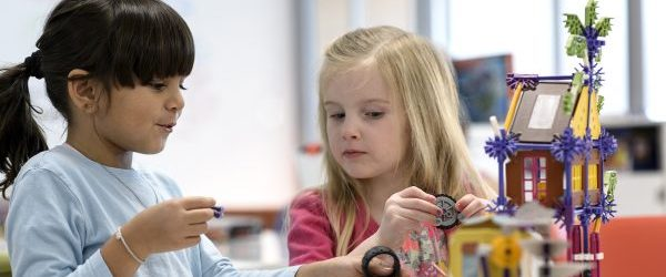 Two girls build a clubhouse together with a toy (Purdue University photo/John Underwood)